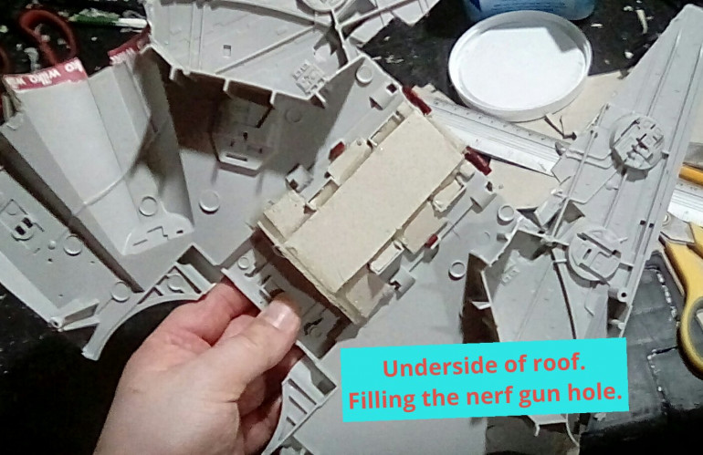 Filling the large hole  where the nerf gun used to be should also give some much needed strength to the front roof area.