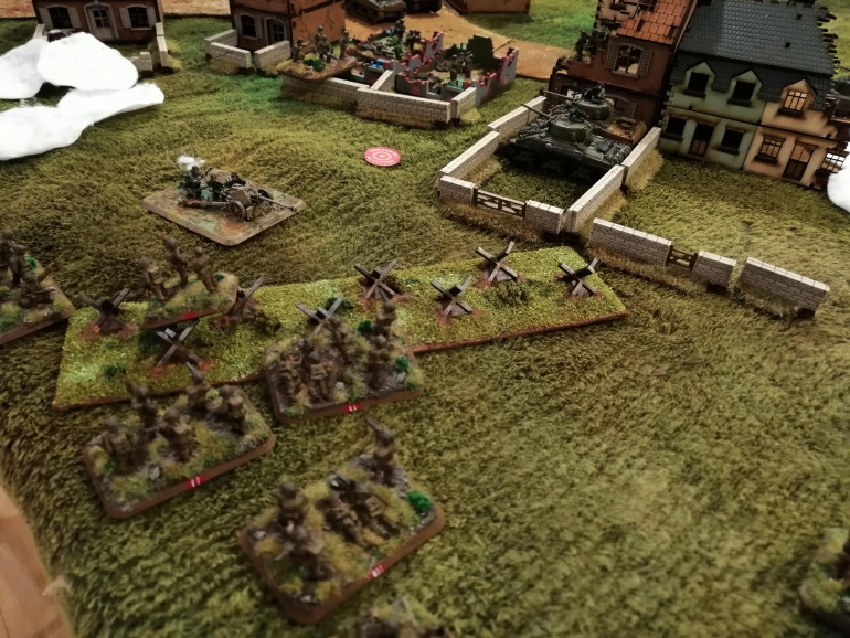 Red Platoon taking cover in the tank traps and preparing to assault the PaK40