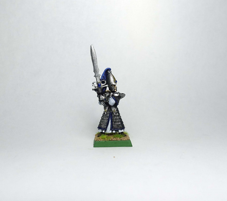 I found a lone sword master from the time I painted my original army and painted it up.