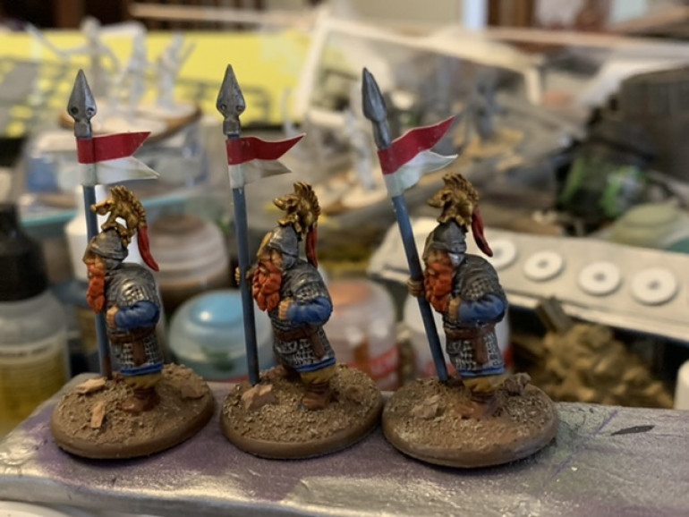 Added some pennants from Flags of War to mark out unit leaders. Saga doesn't use them but Lords of Erehwon does. I cut the pennants out with some small scissors and the coated the backs with PVA glue and the wrapped them around the spear haft.
