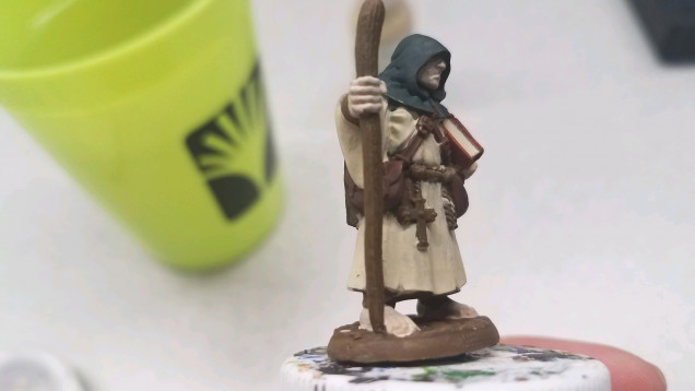 Look between the cross and his satchel, and you can see the missed spot.