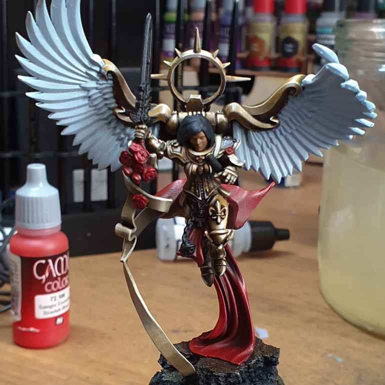 Don't know what happened to my camera here. I painted the cape I started with the base heavy red. Went in with hull red to shade then went over everything in black wash. after this went in with red then for the highlights red ink. This left it quite shiny.