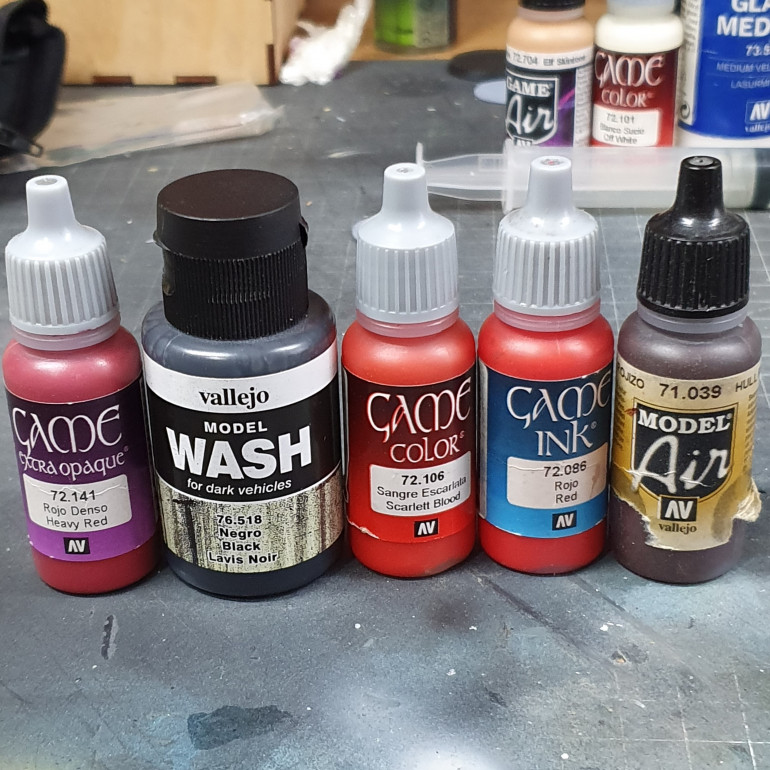 Paints used to paint the red cape and roses.