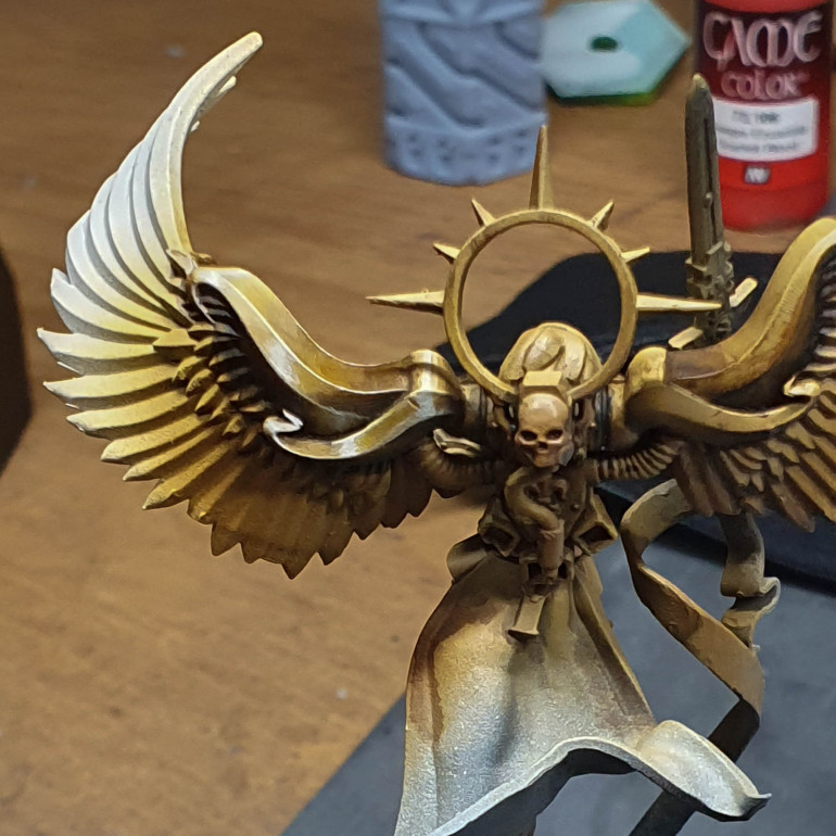 I based the model in gold brown  shaded with sepia ink then black and highlighted by adding white to the gold brown I took the first section. I think this is the only real way of doing this. Taking a part at a time then painting this.