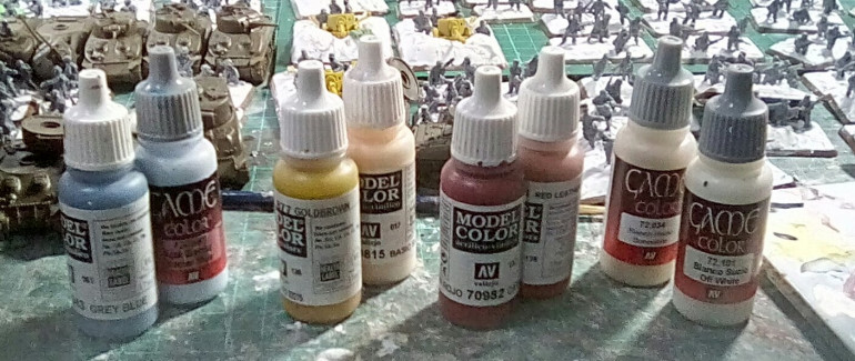 The paints I used to paint the coloured panels. 2 thin costs of the watered down darker base colour, then overpainted with the lighter shade letting the darker shade show at the edges. Then firebrand aged with the 2 off-white shades.