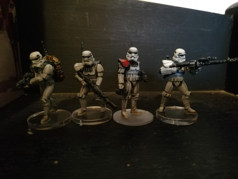 I have used the shoulder pauldrons to rank my minis. Orange for captains white for sergeants and black for trained troopers