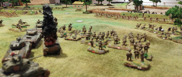 The 1st Canadian Armoured Brigade continue their advance past the burning wreck of the lead tank