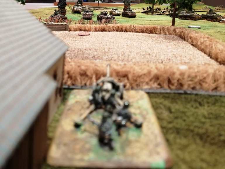 Another PaK40 breaks cover and opens up on the advancing 1st Canadian Armoured Brigade
