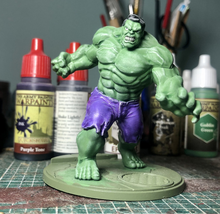 So here he is after a green and purple wash and then another dark tone wash over the whole model.
