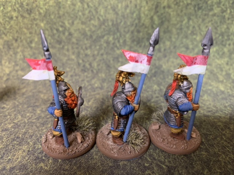 As the last step for these figures, I sprayed them with Army Painter Matt Varnish and as you can see, it discolored the paper pennants.   Lesson learned? Put the pennants on after the varnish step.