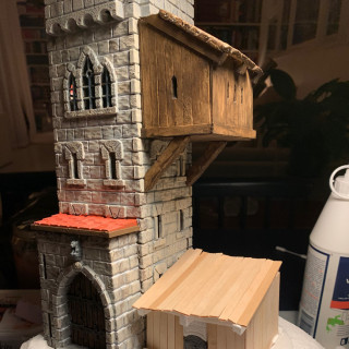 Building the base and a small shed next to the tower.