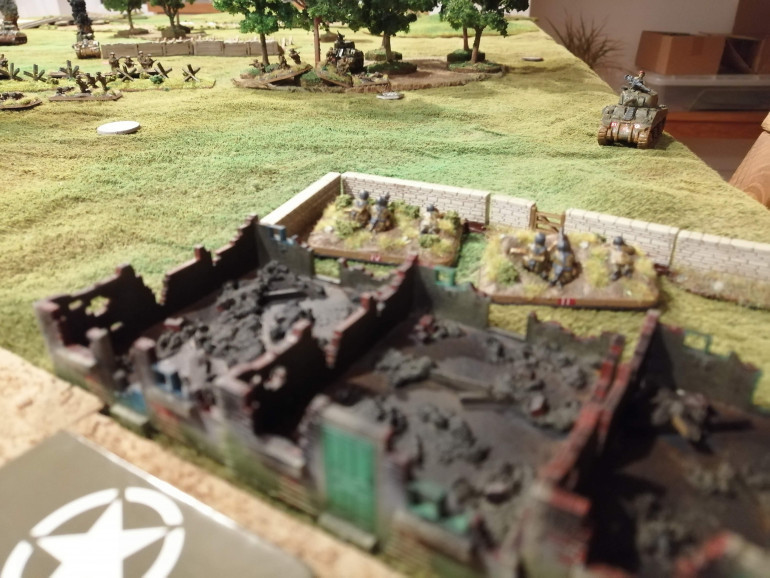 A couple of German MG teams lay down some fire on Red Platoon in the trees while the Sherman advances on their position