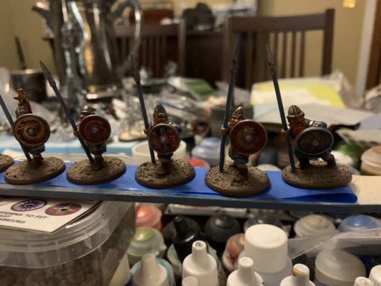 Once the shields were painted I applied the transfers are previously then glued the shields onto the minis. I then based the minis as previously adding the cork rocks and the tufts.