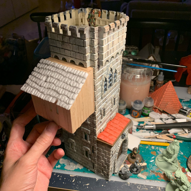 Here you can see me putting together this part with small ice cream sticks and a thin foam as tiles for the roof. I had also started painting the tower in a lighter stone tone with red/orange roof tiles. I wanted it to look similar to the medieval buildings in Visby Gotland here in Sweden.