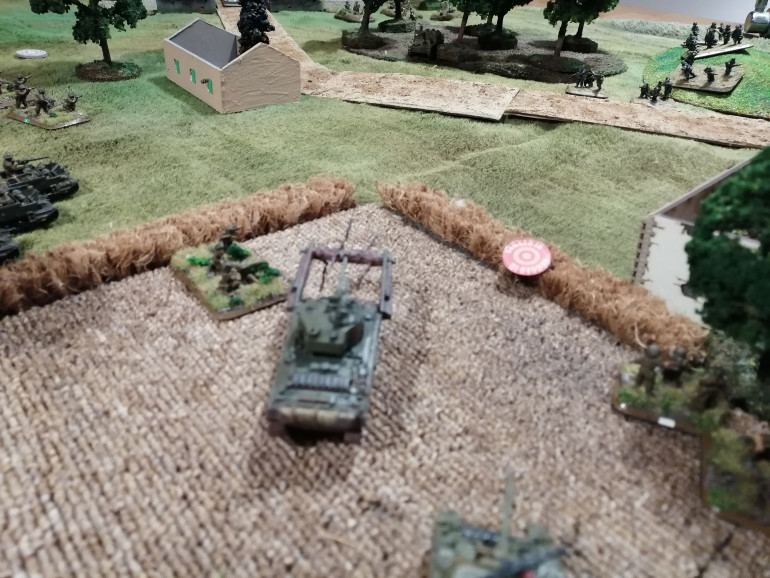 A Sherman Crab attempts to cross the hedgerow - no easy feat given the massive mine clearing equipment attached to the front