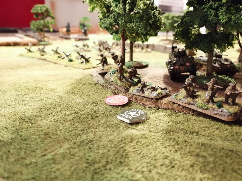 Red Platoon, supported by two Shermans, pinned down in the trees