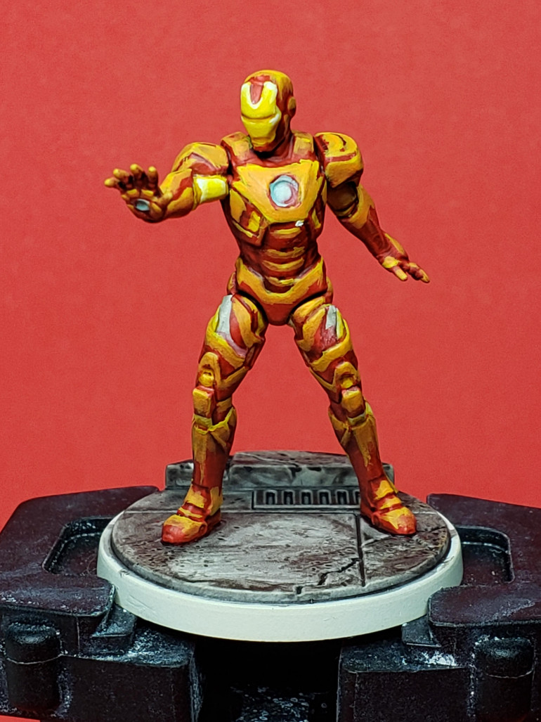 So this is step 2 on Iron Man, bringing in a mix of Fire Dragon Bright to the Flash Gitz Yellow to feather the bright yellow highlights into the red. As you can see, it still looks very, very terrible. Hopefully it'll look better and better as more layers get added in.