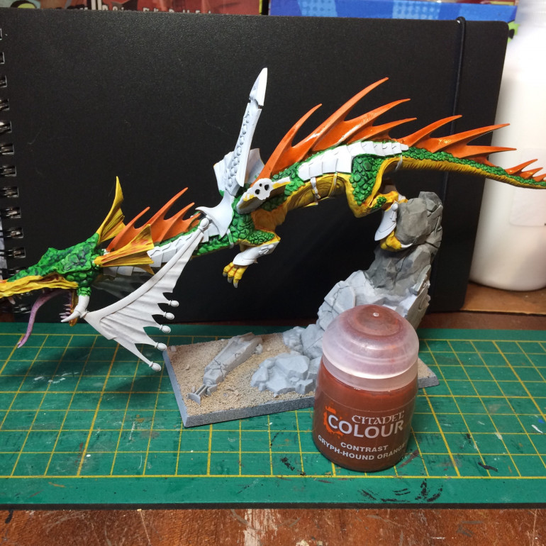 It's a ginger! GryphHound orange for the spine. It's at this point my plans change. It was just going to be a pretty standard yellow and green forest dragon but I really like the fiery orange...