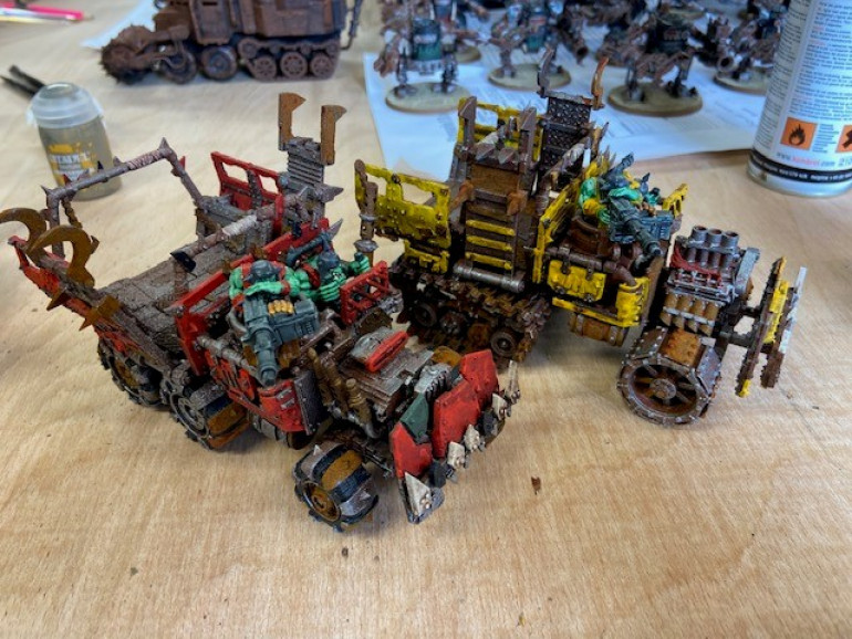 Bad Moons Trukk along side an Evil Sunz Trukk. If I had base coated the Bad Moons Trukk yellow, it would have looked very different and in my mind, not blended in with the rest of the army.