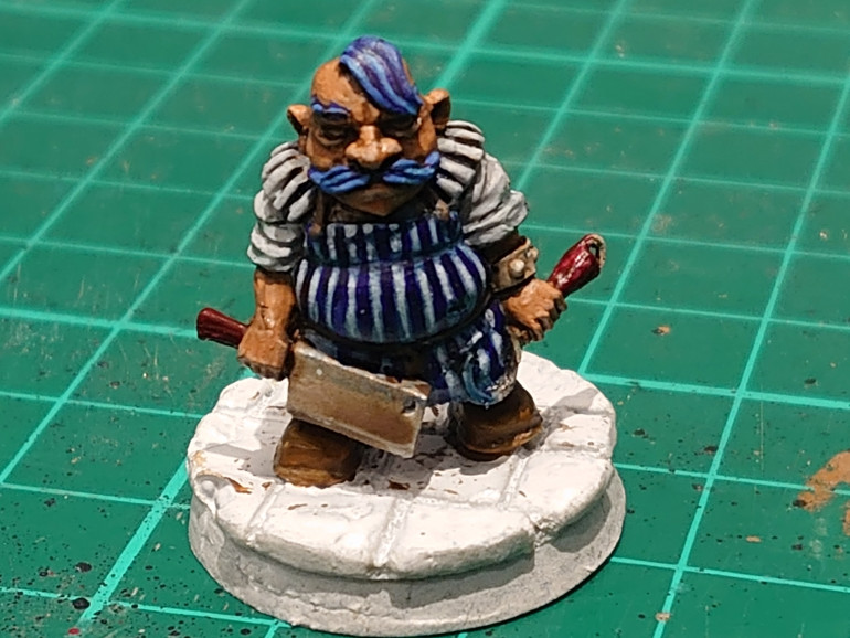 So first up on the block is Gowak the Butcher. A stout fellow, I decided to go with a blue theme. For him to match the butch striped apron. I am going to try and get as much colour into the mini's as possible.