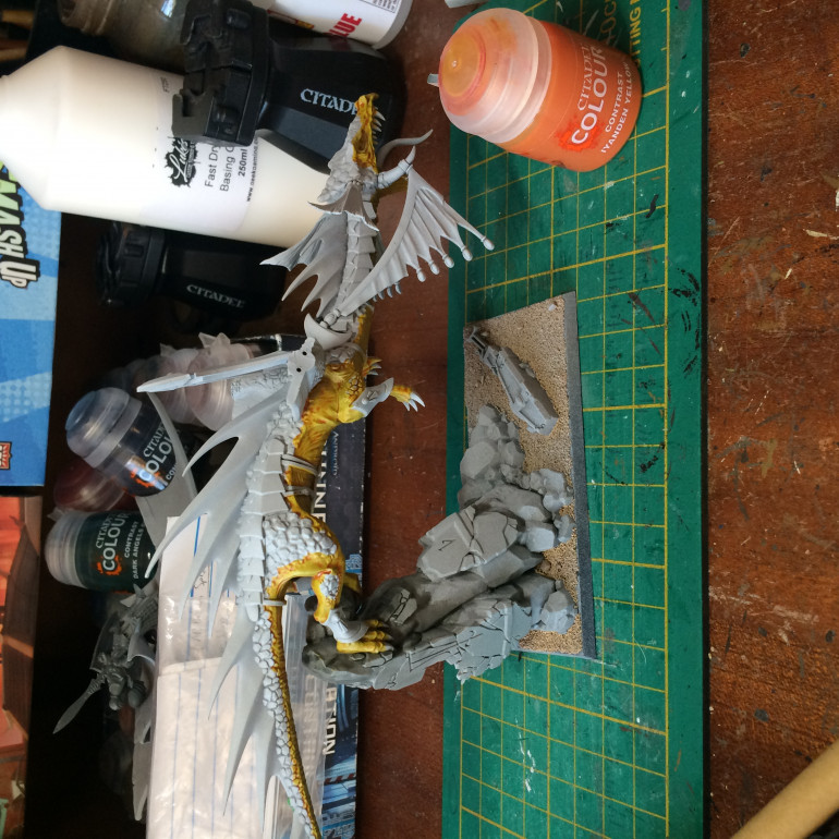 Wings now have pins in them. Sprayed grey the zenithed with Greyseer and white. Skin done with contrast Iyanden yellow.