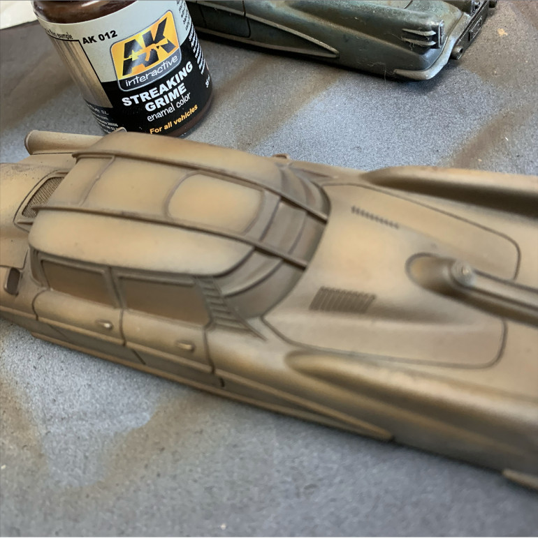 Spray over all the good work so far with Streaking Grime. It's an enamel wash so is not water soluble. Wear a mask when spraying and clean the airbrush by flushing through white spirit.