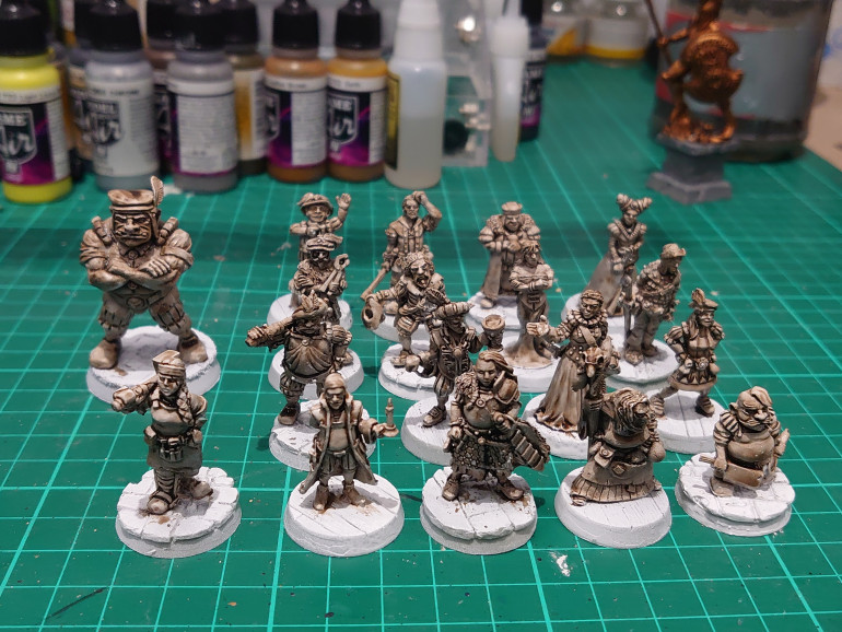 After a primer of Army Painter spray, I washed all the figures in the Army Painter strong tone.