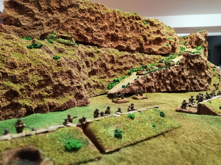 Some of the Fallschirmjager's defensive positions. Note the MG nest looming over the battlefield on the hill