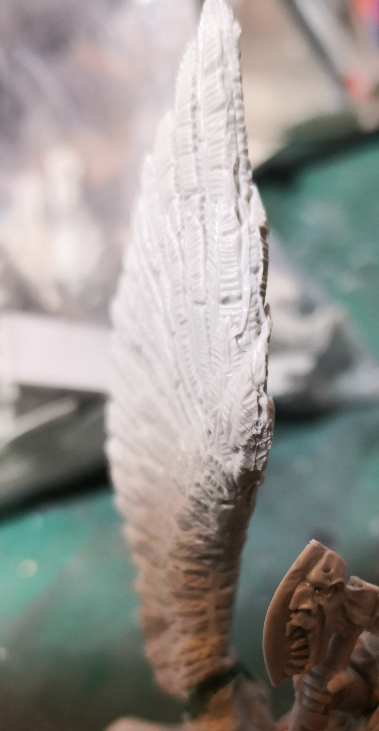 On the wing of the war boss's bull mount the most prominent feather near the dwarf's head had near no detail due to being an attachment point of the scaffoling. I had to try and carve it back in. I think it'll do.
