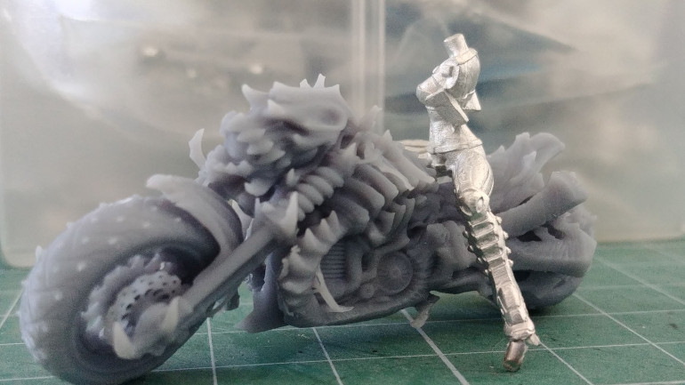 Proof of scale. This is a body of an Infinity miniature on the bike, fits perfectly.