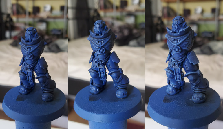 First the model wash shaded with an all-over coat of Nuln Oil, followed by a heavy drybrush of Macragge Blue, then finally a drybrush of Calgar blue to define the edges.