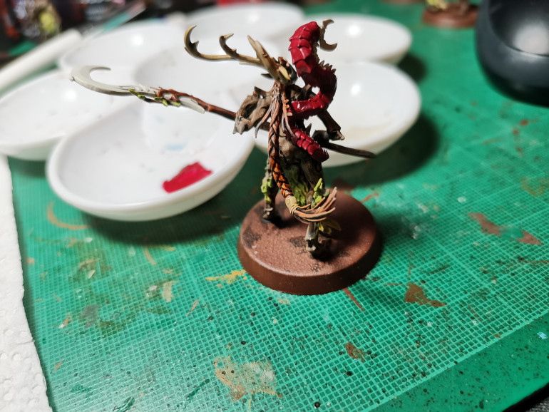 The Bug's Carapace is painted Khorne Red and dry brushed Squig Orange for subtle a highlight. Skeleton Horde for the antlers and the bone hairband thing in the hair. The hair is painted with Gore Grunta fur, this is an amazing contrast paint which I have plans to use more later in the project.