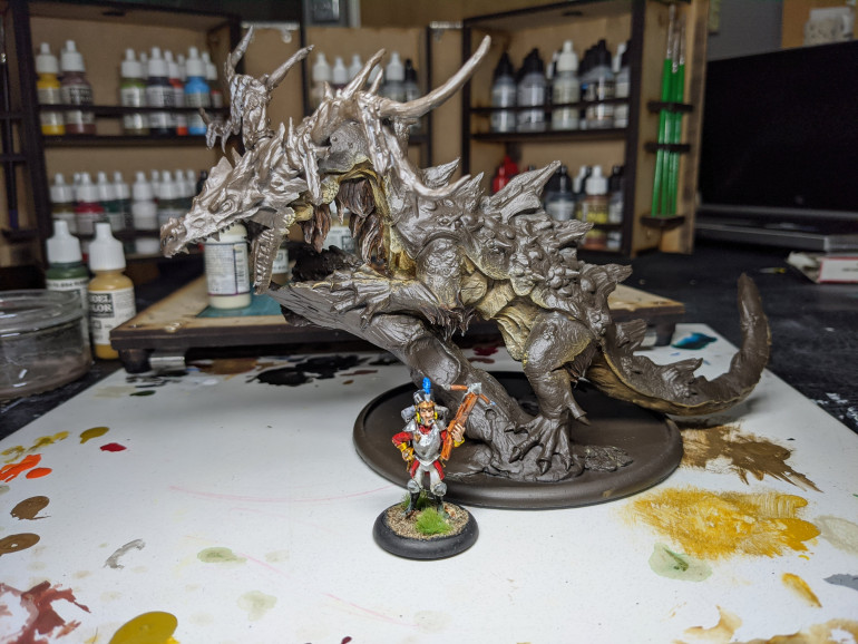 The big guy, human for scale, but you can see the fur around the legs and neck done.  This was gorgrunta fur contrast then drybrushed bone before a sepia wash