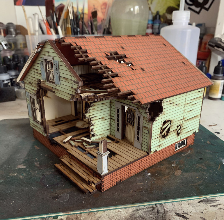 House built. I think I now need to weather the mdf stuff a bit to make it fit with the wasteland. Shouldn't need a lot but a bit of grubby tone should help.