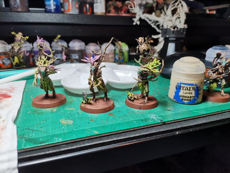 One problem I had when battling on the tabletop was that I kept forgetting about my dryad leader's extra attack dice and I  never could tell at a glance which blob of branches was in charge. So I wanted to differentiate the leaders. Easiest option; I took Skeleton Horde contrast paint  and painted their hands/branch tips and viola a dryad born to lead. Oh yeah, dry brush Ushabti Bone and your done!