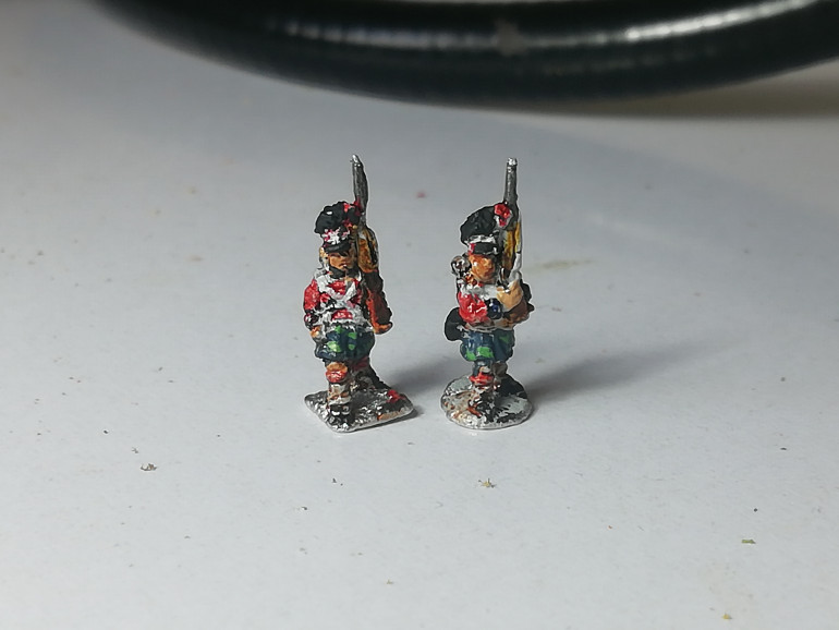 I gave the kilts a couple of dabs of lighter green to give the impression of tartan pattern