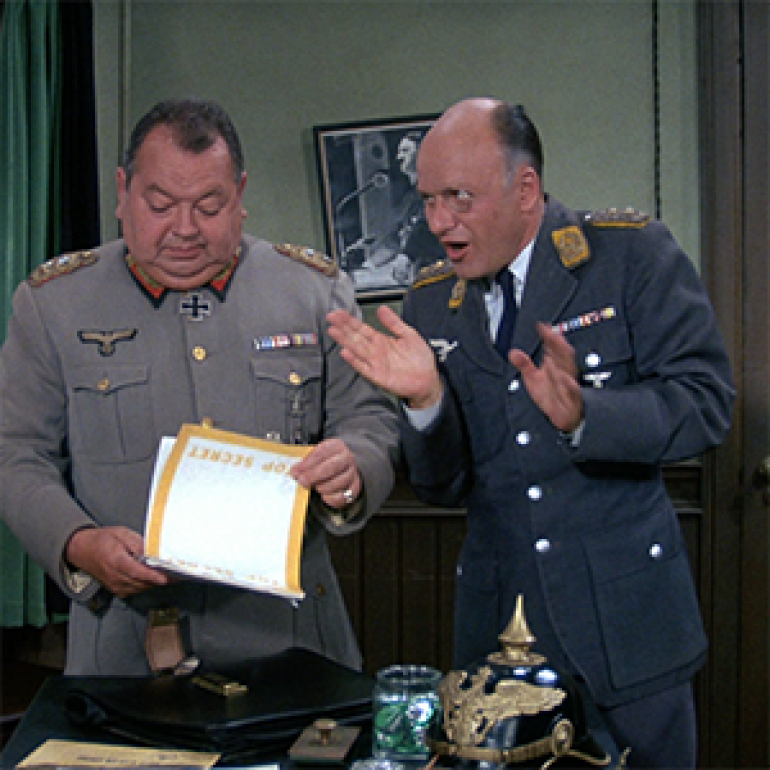 Very historical research, as you can see! Jokes aside, Hogan's Heroes actually seems to have gotten the uniforms of Klink and Schultz pretty well, even if there are some minor issues such as Norwegian/Danish rifles... (We could argue that they are Stomperud Krags, I guess.)