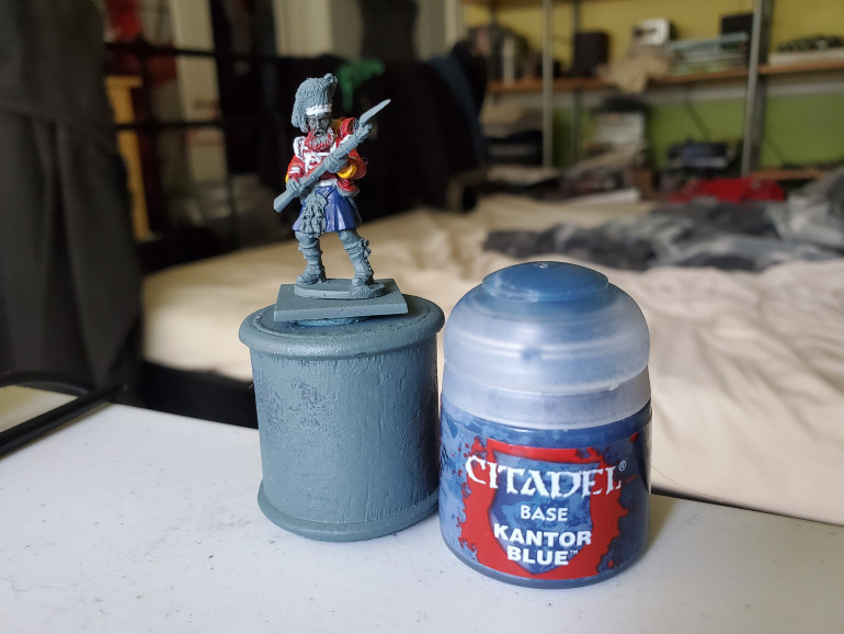 A nice solid basecoat of Kantor Blue is the starting point. Make sure it is nice and solid and be careful of any jacket tails or bits and bobs that you already painted. This is actually why I left the backpack and many of the accoutrements until after the kilt.
