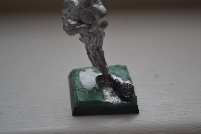 Spent a bit of time building up the sides of the base with greenstuff like the last model.