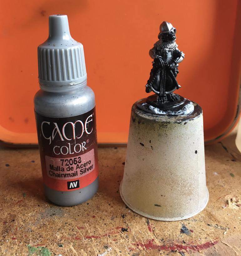 Over a black undercoat, all the metals are given a base coat of Vallejo Chainmail Silver