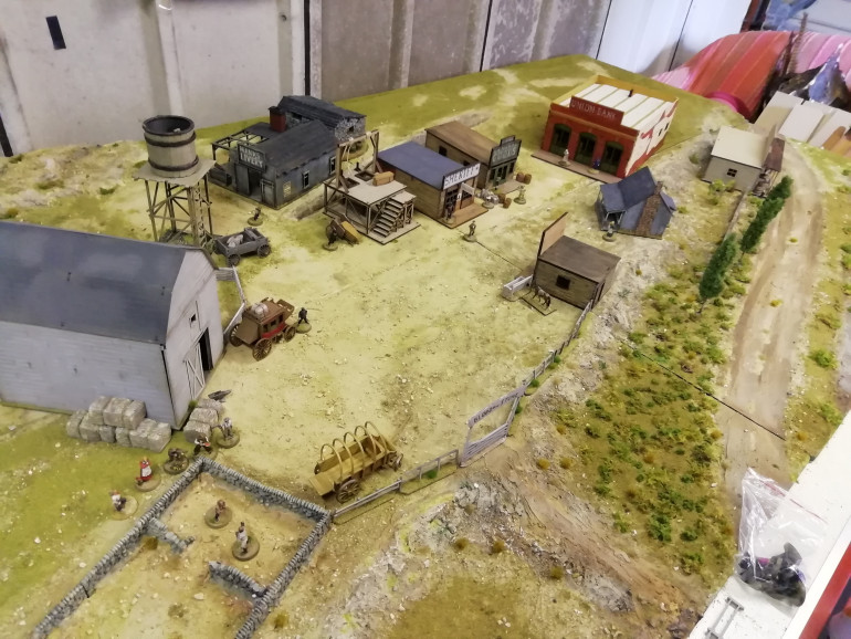 After completing my new trading post kit I got the town out on the board bi made for Rorkes Drift and it works well for the western setting