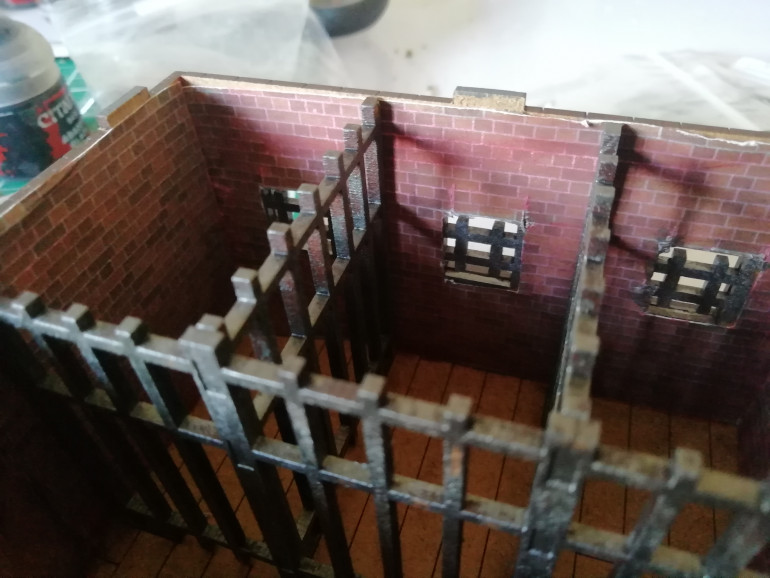Added a printed brick wall to the cells to match the exterior