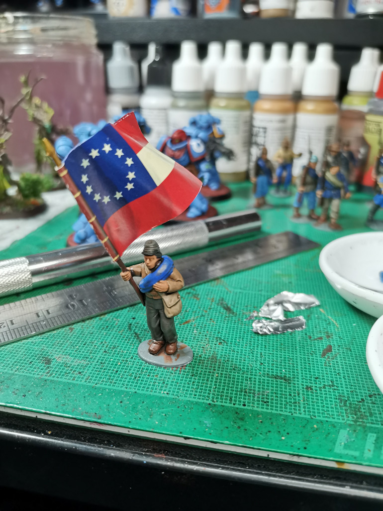 First attempt at a flag has turned out pretty good, I just need to go around the edge in red, white and blue to hide the white edge of the paper. Flag came with the set from Perry Minis