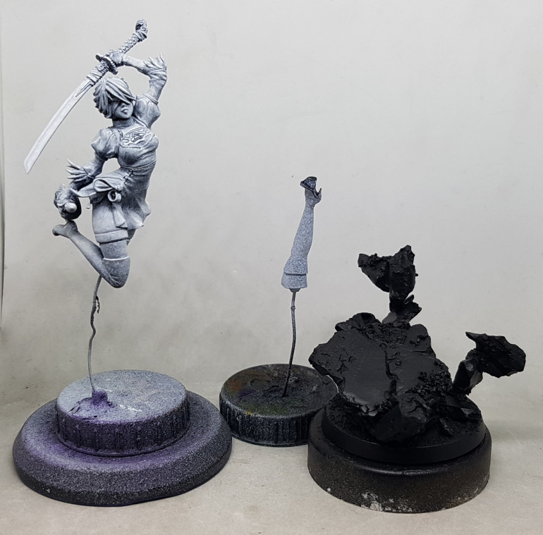 Cyber Beauty by Klukva, to be painted in 3 separate parts.  That base was a PITA to figure out how it goes together.  Anyone got any good guides for how to paint black stockings or white hair?
