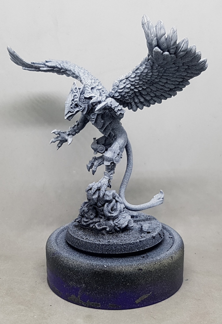 Kerub the Armoured Griffin by Legends of Signum.  That tail is supposed to rest flat on the base.  Its flat on the underside.  Thats one hell of a miscast