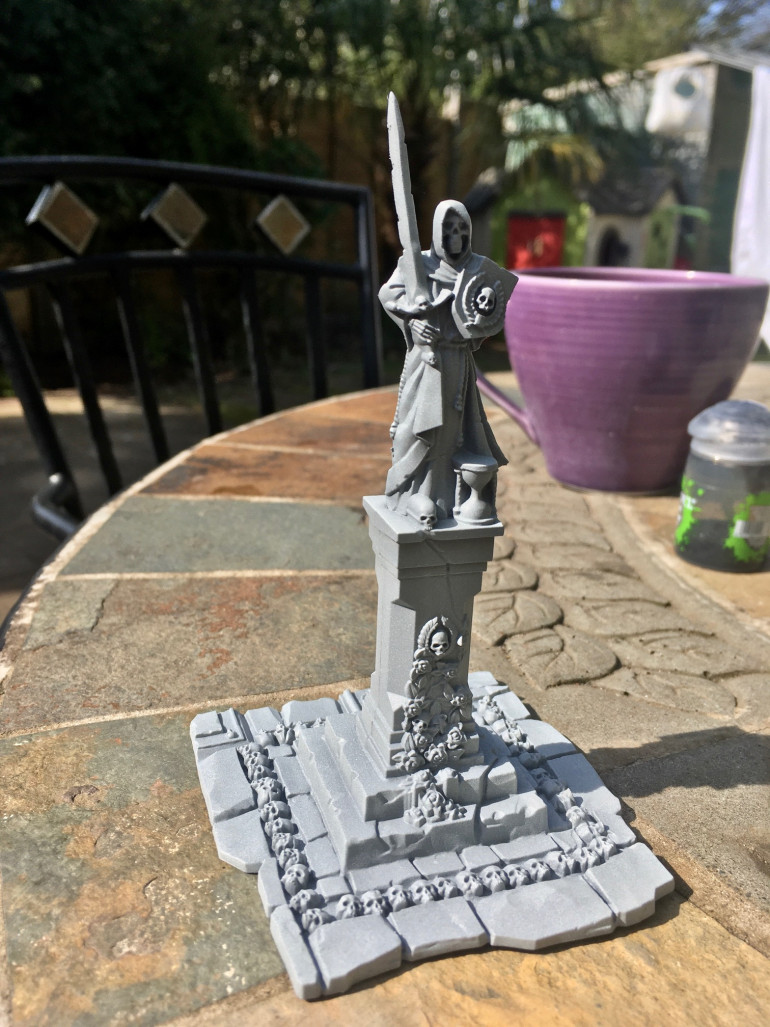 Primed model - in this case a statue from the Sigmarite Mausoleum set.