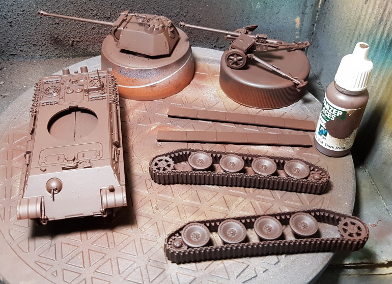 I don't have the paints used in the video so I am approximating from my collection.  First up, a base undercoat of VMC Dark Rust over primer.  This was then sealed with Matt Varnish.