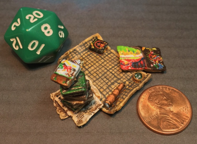 It was pointed out that I needed a shot showing scale so here are a d20 and a US penny to help with that.
