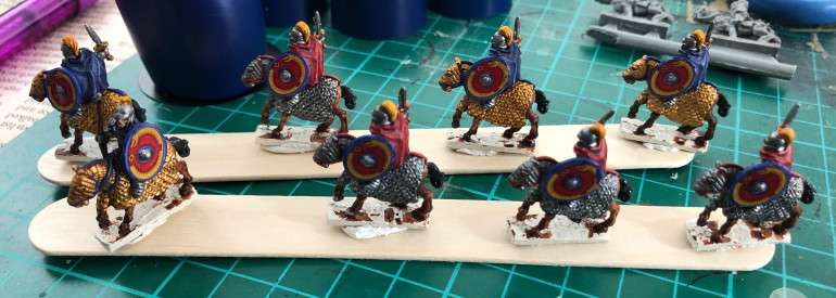 Layers added on details, (base layer, with lighter shades of base layer on top for details, but with skull crusher brass as final layer for gold armour). Also added shields.