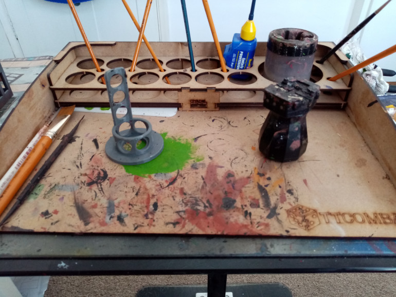 This is my workspace which has all my paint brushes, a miniature holder and a 3D printed paint holder